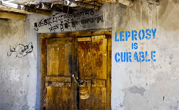 Graffiti promoting awareness that 'Leprosy is curable'